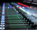 image of a digital mixing board console versus analog sound board
